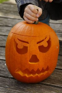 carving a Halloween jack-o-lantern