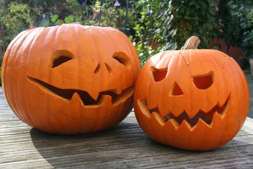 two jack-o-lanterns on deck