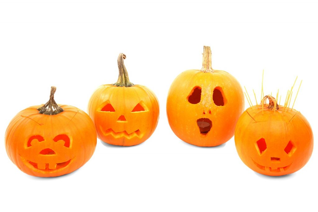 4 funny pumpkin faces carved